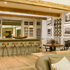 Rustic Family Room by Jett Thompson Antiques & Interiors