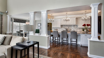 Gray and White Great Room with Nesting Tables, Pillars and Oak Floors