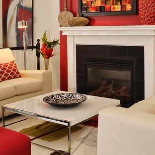 Example of a mid-sized classic enclosed carpeted and beige floor family room design in New Orleans with beige walls, a standard fireplace and a tile fireplace