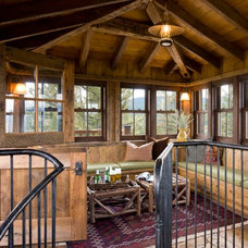 Rustic Family Room by On Site Management, Inc.