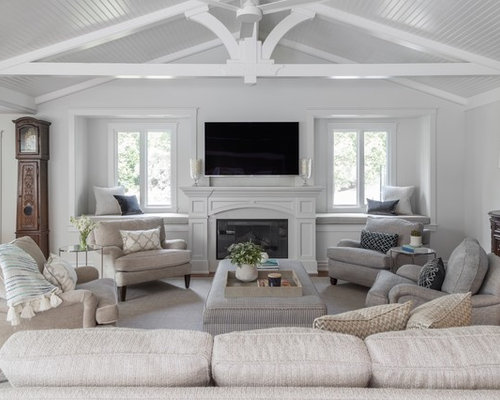 living room designs with fireplace. Example of a large classic open concept medium tone wood floor and brown  family room 25 Best Traditional Family Room Ideas Designs Houzz