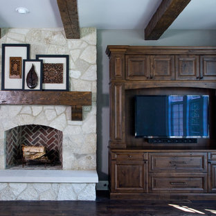 Great Room featuring Stone Fireplace with Hand Hewn Timber Mantle