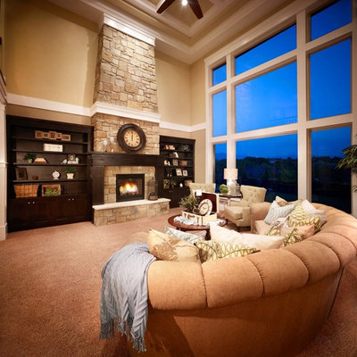 Family room - large traditional open concept carpeted and brown floor family room idea in Salt Lake City with beige walls, a standard fireplace, a stone fireplace and no tv
