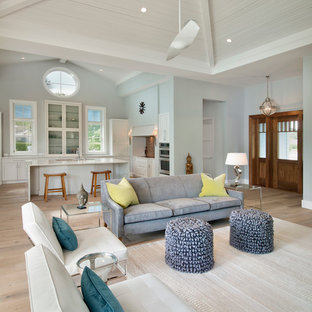 Family room - mid-sized coastal open concept family room idea in Tampa with gray walls, no fireplace and a concealed tv