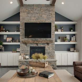 Example of a large transitional open concept dark wood floor and brown floor family room design in Nashville with gray walls, a standard fireplace, a wall-mounted tv and a stone fireplace