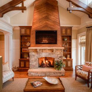 Idée de décoration pour une salle de séjour tradition avec une cheminée standard, un manteau de cheminée en pierre et un téléviseur fixé au mur.