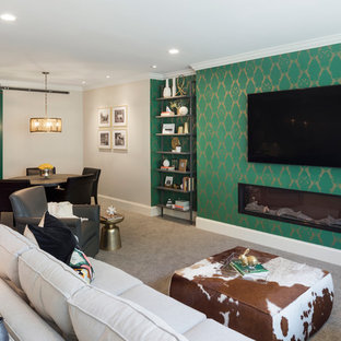 Family room - transitional open concept carpeted and gray floor family room idea in Minneapolis with green walls, a ribbon fireplace and a wall-mounted tv