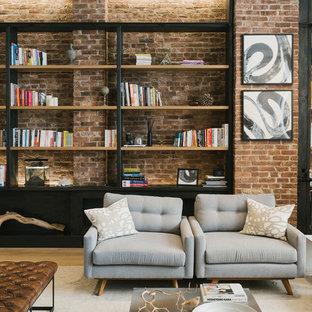 ニューヨークの大きいインダストリアルスタイルのおしゃれなファミリールーム (ライブラリー、淡色無垢フローリング、白い壁、暖炉なし、テレビなし、ベージュの床) の写真