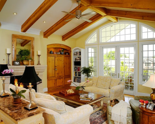 Example Of A Classic Medium Tone Wood Floor Family Room Design In Denver  With Yellow Walls