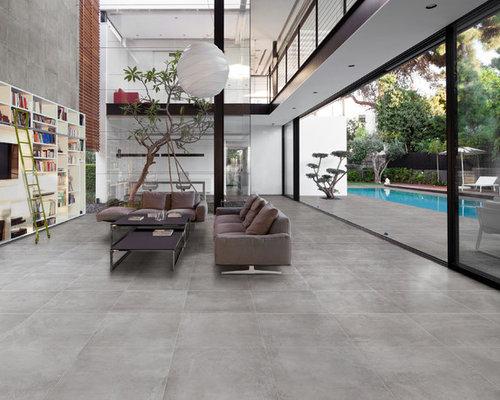 Foto e Idee per Soggiorni - soggiorno con pavimento in gres porcellanato e libreria
