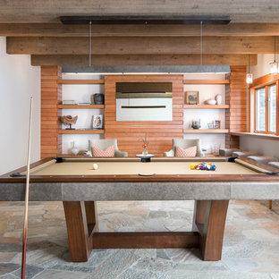 Immagine di un grande soggiorno minimal chiuso con sala giochi, pareti bianche, TV nascosta e nessun camino