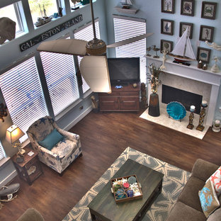 Inspiration for a mid-sized coastal open concept medium tone wood floor family room remodel in Houston with blue walls, a standard fireplace, a tile fireplace and a tv stand