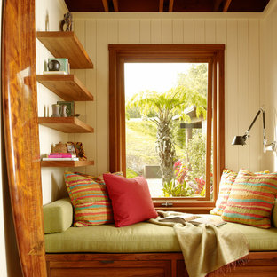 Photo of a tropical family room in Hawaii with beige walls and medium hardwood floors.