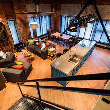 Industrial Family Room by Beyond Beige Interior Design Inc.