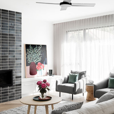 Family room - contemporary open concept medium tone wood floor and brown floor family room idea in Melbourne with white walls, a standard fireplace, a brick fireplace and a wall-mounted tv