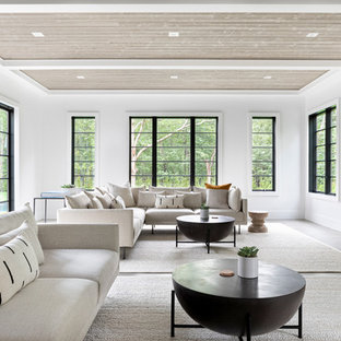 Inspiration for a large coastal open concept dark wood floor and gray floor family room remodel in New York with white walls, a hanging fireplace, a stone fireplace and a tv stand