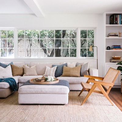 Inspiration for a mid-sized transitional dark wood floor and brown floor family room remodel in Los Angeles with white walls