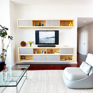 Mid-sized trendy medium tone wood floor family room photo in New York with white walls, a wall-mounted tv and no fireplace