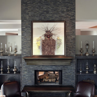 Example of a large trendy medium tone wood floor family room design in Grand Rapids with gray walls, a standard fireplace and a stone fireplace