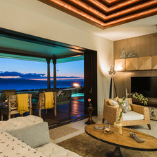Tropical Family Room by Island Essence Interiors