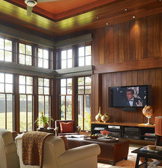 tropical family room by Slifer Designs