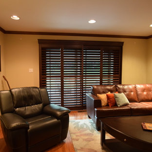 Mid-sized transitional enclosed medium tone wood floor family room photo in Chicago with yellow walls