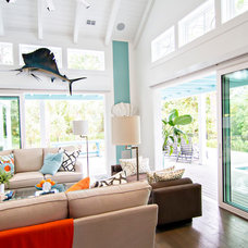 Tropical Family Room by Glenn Layton Homes