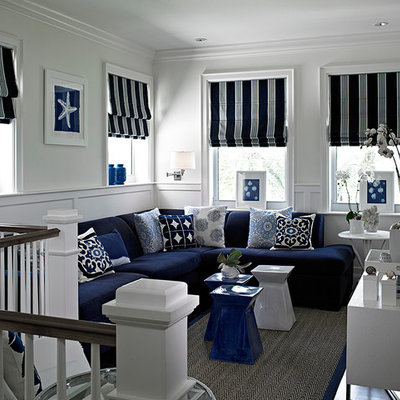 Example of a mid-sized transitional loft-style dark wood floor and gray floor family room design in Miami with white walls, no fireplace and a wall-mounted tv