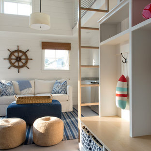 Example of a mid-sized beach style painted wood floor family room design in Portland Maine with white walls