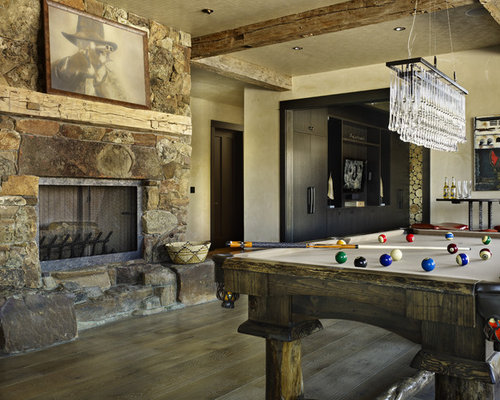 Mountain style game room photo in Denver with beige walls, a standard  fireplace and a