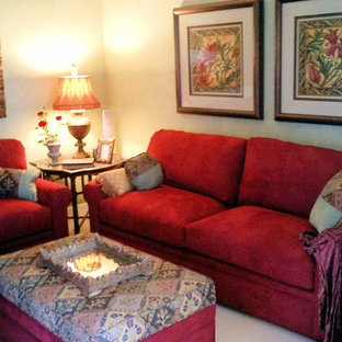 Family room - mid-sized mediterranean enclosed carpeted family room idea in San Diego with beige walls and a media wall