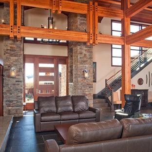 ポートランドの広いおしゃれなオープンリビング (ミュージックルーム、ベージュの壁、カーペット敷き、標準型暖炉、石材の暖炉まわり、壁掛け型テレビ、マルチカラーの床) の写真