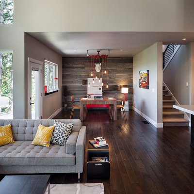 Example of a large trendy open concept dark wood floor and brown floor family room design in Portland with gray walls