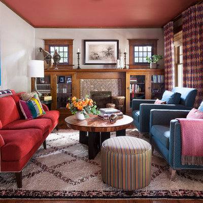 Family room - eclectic medium tone wood floor and brown floor family room idea in Denver with white walls, a standard fireplace and a tile fireplace