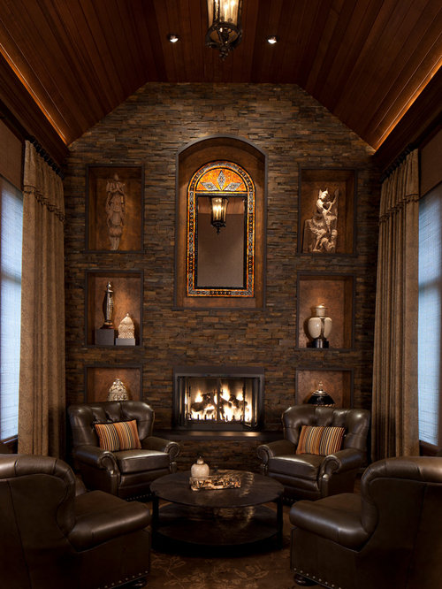 Elegant family room photo in Chicago with a stone fireplace surround