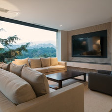 Traditional Family Room by RHYZOMA - Arquitectura / Diseño