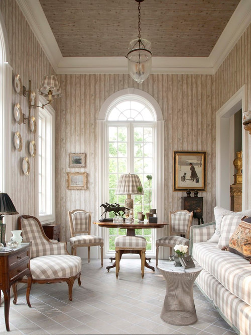 old world living room. Traditional enclosed family room idea in Houston with beige walls Old World Room  Houzz