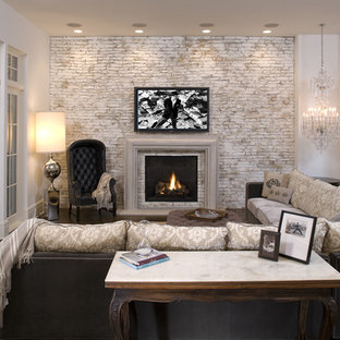 Example of a tuscan family room design in Minneapolis with a brick fireplace