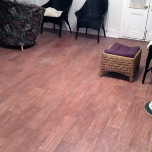 Example of a classic light wood floor and brown floor family room design in New Orleans