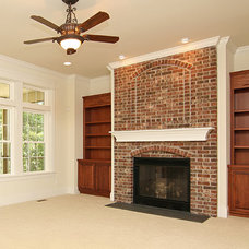 Traditional Family Room by Heartlands Building Company