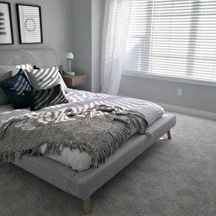 Ispirazione per un soggiorno tradizionale di medie dimensioni e aperto con pareti grigie, pavimento in laminato, TV autoportante e pavimento beige