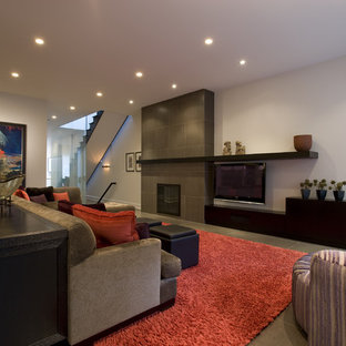 Example of a trendy family room design in Chicago with a tile fireplace