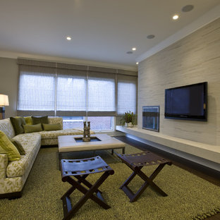 Inspiration for a transitional dark wood floor family room remodel in Chicago with a standard fireplace and a wall-mounted tv