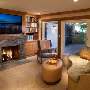 Inspiration for a contemporary carpeted family room library remodel in Santa Barbara with beige walls, a standard fireplace, a stone fireplace and a wall-mounted tv