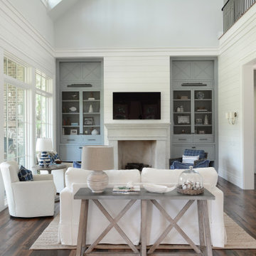 Hopes Neck Farmhouse Living Space with Built-Ins and Fireplace