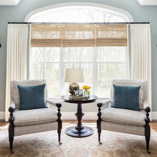 ボストンの大きいトランジショナルスタイルのおしゃれなファミリールーム (濃色無垢フローリング、テレビなし、青い壁、暖炉なし、茶色い床) の写真
