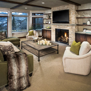 Mid-sized trendy open concept carpeted and beige floor family room photo in Denver with beige walls, a standard fireplace, a stone fireplace and a wall-mounted tv