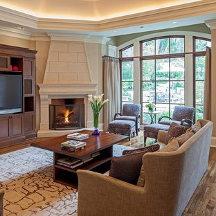 Example of a classic family room design in Toronto with a corner fireplace