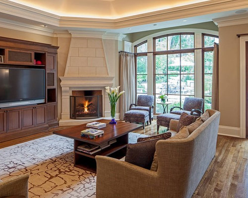 Example Of A Classic Family Room Design In Toronto With Corner Fireplace