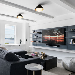 Example of a trendy dark wood floor and brown floor family room design in New York with white walls, no fireplace and a wall-mounted tv